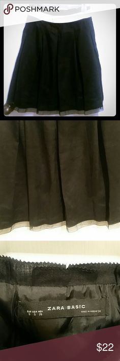 ZARA Black Pleated Skirt Women's ZARA black skirt with small tulle edge on bottom Top has a white ribbon all around waist Size Small Fully Lined GUC- no flaws like snags, rips, or stains Material tag was cut out -it is like a linen/cotton blend Very sturdy but beautiful material with pleats all around I'd suggest dry cleaning (as I do most of mine anyway) Waist 14 in Length 24 in Zara Skirts A-Line or Full
