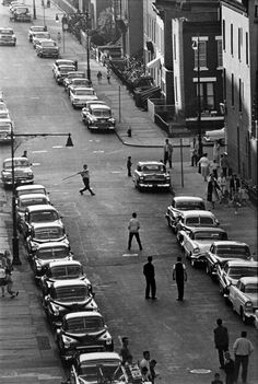 Neighborhood kids playing stickball in the streets. Brooklyn, 1959. By Bruce Davidson