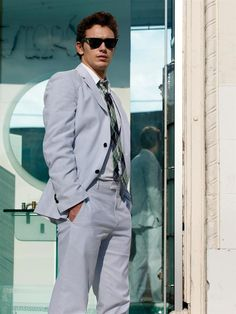 james franco. love a light grey suit with punchy tie. the raybans are a give-in.
