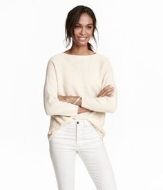Light beige. Straight-cut sweater in a soft, rib knit with wool content. Slightly wider neckline and 3/4-length sleeves.