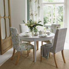 Small Dining Room Ideas with Round Dining Table and Covered Dining Chairs
