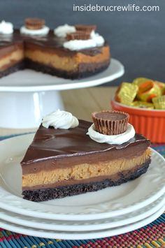 Peanut Butter Cup Cheesecake - chocolate and peanut butter cheesecake layers with a chocolate topping and Oreo cookie crust