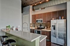 This kitchen design is found in a Sixth Floor Urban Modern luxury 1 Bedroom unit at One Lexington priced $209K