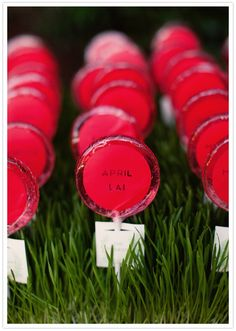 Lollipops Escort Cards!  This is great!! An Escort Card.  A Favor.  A Sweet Treat!  An Accent Color.  What more could you ask for?  Photograph by Ashley Rose via 100 Layer Cake