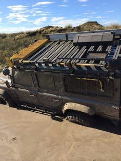 Land Rover Defender, stuck. But only for a moment rig up the winch and sorted