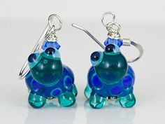 Hey, I found this really awesome Etsy listing at https://www.etsy.com/listing/170432418/turtle-lampwork-bead-earrings-blue-green