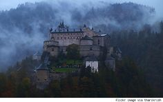 Hohenwerfen  Location: South of Salzburg, Austria   Nearest airport: Salzburg Airport   Year originally built: 1078   Inhabitants: Salzburg rulers and prisoners   Interesting fact: The misty castle served as a prison for hundreds of years.