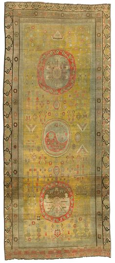 A Samarkand rug BB4385 - An early 20th century Samarkand (Khotan) rug, the yellow field with flowering branches around a central column ...
