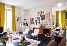 Consuelo Castiglioni, founder and designer of fashion brand Marni uses a broad range of artworks and objects to add cheerful colour to her home in Milan.  Image: Danilo Scarpati.