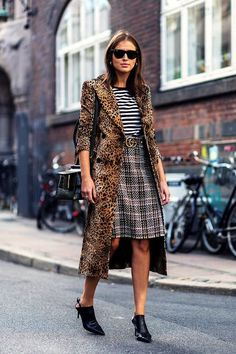 Photo via: The Zoe Report This street style look is dream inspiration for all of the mixed print fans out there. (You know who you are.) It combines some of our favorites for fall including leopard, s