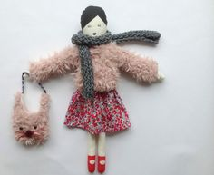 Lou lou dol, a handmade fabric doll with a lovely liberty skirt and a very soft fake fur coat ( completly lined ) comes with a greay scarf and a very