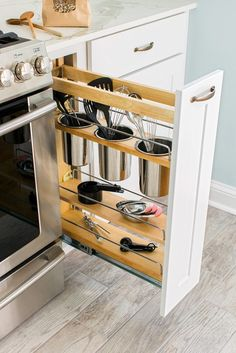 A pull-out cupboard with utensil holders for easy access to tools and utensils