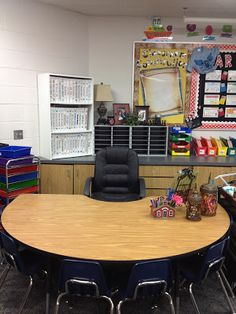 Get rid of the bulky traditional teacher's desk and replace it with a group table. Store your supplies in drawers.