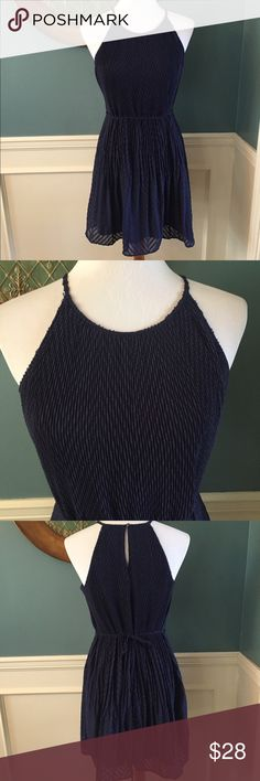 ELLE Navy Blue Pleated Trapeze Dress ELLE navy blue pleated trapeze dress. Textured pleat design, crew neck, button-back closure, spaghetti straps. This dress is light, flowing and flattering. Perfect for spring. Only worn once! Elle Dresses
