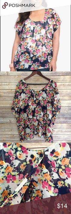 """Torrid Floral Tulip Back Top Torrid floral tulip back top.  Women's size 2, plus size.  It is open back, has two buttons on top to close the blouse.  Very cute floral print.  Has a tiny hole as seen on the last picture, pre-owned, great condition.  100% polyester.  Armpit to armpit- 26.5"""" length- 28"""". torrid Tops Blouses"""