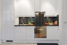 Small black and white kitchen.