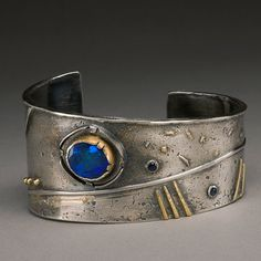 Earth, Wind, Fire Cuff / Bracelet with Sterling Silver , 18K Gold, Blue Fire Opal, and Sapphires via Etsy