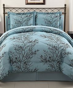 Blue & Chocolate Leaf Comforter Set.... This would be cute in black and white or black and burgundy