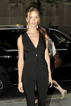"""Rosie Huntington-Whiteley stops to pose for photographers as she arrives at the Jimmy Fallon show in New York. The model and actress is touring the chat shows promoting the movie """"Transformers: Dark of the Moon""""."""