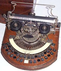 Image result for world's oldest typewriter round
