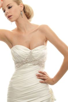 i'm obsessed with wedding dresses... simple and plain to large and full of detail.. love them all!