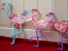 two heart shapes and glue the pipe cleaner neck and pipe cleaner legs along with a feather tail between them  http://mermaidscreations.wordpress.com/2012/02/01/5826/