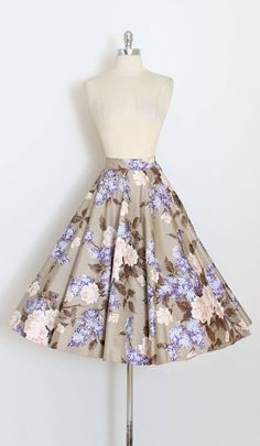 ➳ vintage 1950s skirt * amazing printed skirt! * polished cotton in muted tones * lilac and floral print * pink rhinestones, metal studs and sequins * back in tulle * metal zipper condition | excellent fits like xs/s length 30 waist 26 ➳ shop http://www.etsy.com/shop/millstreetvintage?ref=si_shop ➳ shop policies http://www.etsy.com/shop/millstreetvintage/policy twitter | MillStVintage facebook | millstreetvintage instagram | millst...