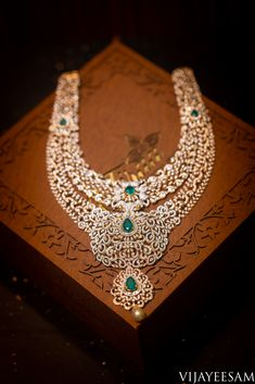 South indian pellikuthuru attire will be complete with this three stepped incredible diamond set studded with emerald along with a pearl drop. #jewellery #jewelleryphotography #diamondnecklace #indianjewellery #bridesessentials diamondrings #diamondneckpiece #indianbridesjewellery #wedding #indianwedding #southindianwedding #Vijayeesamphotography #photographycompany #besthyderabadphotography #vijayeesamandco #weddingphotography #inspired #bestcapture