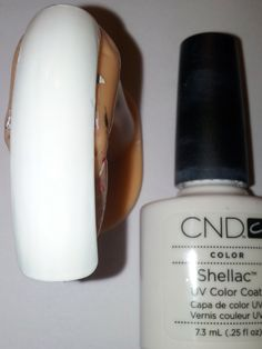 Aply 2 layers of CND Shellac and cure in the UV-lamp 2 minutes per layer.