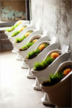 Urinals used as planters -- I've officially seen it all. Photo by Greg Slick Photography, from @wedding chicks