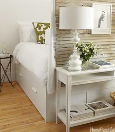 Walls enclose the sleeping area in this 400-square-foot apartment and the bed has drawers underneath for storage.