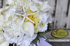 Beach Themed Real Touch Silk Flower Wedding Bouquets, with added sea shells adorned with Malibu blue Swarovski crystal flowers and starfish surrounded by fresh water pearls.