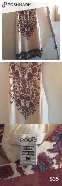 Urban outfitter's festive dress Beautiful flowers on Cream dress. It fastens at the top of the hole in the back but can be covered with cardigan or shown off! Nice maroon and light blue flowers. I wore to concerts and loved! Even cowboy boots would look cute this fall! Ecote Dresses Mini