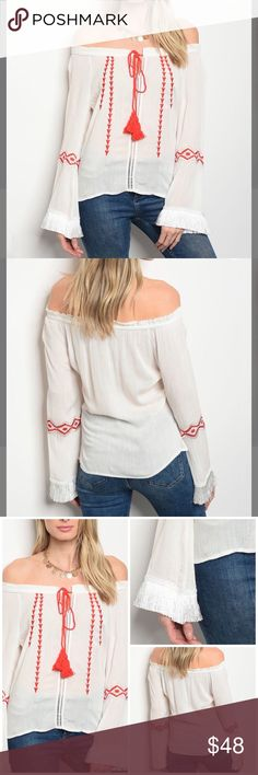 """Embroidered Off The Shoulder Top Unique geometric embroidery gives a charming touch to this off the shoulder top Front tie accent Hidden side Zip to waist gives it a fitted look 100% Rayon Approx measurements  Length: 23"""" Bust: 32-34"""" Tops"""