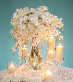 Wedding centerpiece DIY Just add some Butterflies to the flowers and this would be Amazing!