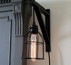 Wall Mount Industrial Cage Light with Cloth Covered Cord and Long Nostalgia Era Bulb ArtifactDesign http://www.amazon.com/dp/B00ZOD623M/ref=cm_sw_r_pi_dp_BHQcxb1QB9HBD