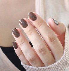 Elegant looking bronze glitter nail art. Add warmth to your nails this winter by painting on glitter polish sandwich designs on your nails.