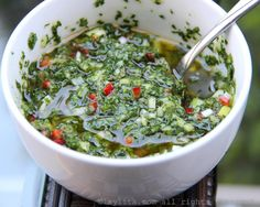 Traditional chimichurri sauce recipe made with parsley, oregano, garlic, onion, red pepper, vinegar and oil. Use to accompany empanadas and grilled meats.