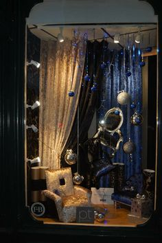 Lavish window display by Dickinson's Furnishers using our luxurious Ritz fabric in colourways Midnight and Seal.