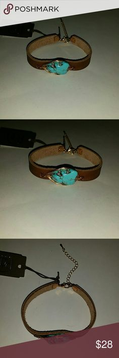 Leather cuff turquoise wire stone bohemian NWT SUPER CUTE BOHEMIAN STYLE BRACELET WITH NATURAL STONE ON BROWN LEATHER CUFF. HAND WIRED AND HAND CRAFTED  NEW WITH TAGS ONE SIZE ONLY ONE LEFT Jewelry Bracelets
