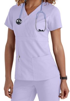 This Grey's Anatomy mock wrap scrub top (in Honey Dew) is seriously soft, revolutionary fabric with built-in mechanical stretch, providing ease of movement for the life of the garment. Dental Scrubs, Medical Scrubs, Nursing Scrubs, Greys Anatomy Shirts, Scrubs Uniform, Scrubs Outfit, Nurse Costume, Medical Uniforms, Work Uniforms