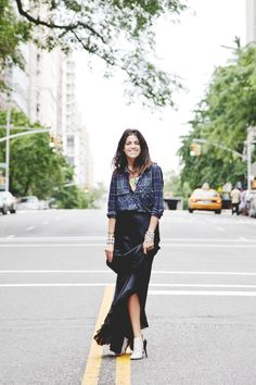 The Man Repeller does it again. Jazzin up the Plaid with tons of jewelry, gorgeous skirt, and some kick butt heels!