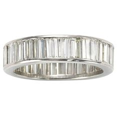 Baguette Diamonds Platinum Eternity Ring | From a unique collection of vintage band rings at https://www.1stdibs.com/jewelry/rings/band-rings/