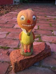 Antique German pumpkin head candy container.