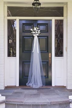 Love this idea of hanging a veil on the door for the bridal shower! | MySweetEngagement.com