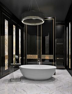 Check out this #bathroom and the sleek black and gold theme. www.remodelworks.com