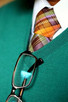 Bright plaid necktie paired with V-neck sweater. Great color combo for the summer!