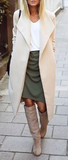 Cream coat & olive green skirt w/ oatmeal boots. Love these colors together. A lacey top in ivory or champagne would add some texture while staying in the color palate better than the stark white one pictured.