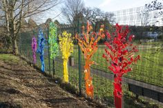 Rainbow Trees From Up-cycled Plastics Recycled Art Recycled Plastic Fence Weaving, Plastic Art, Plastic Items, Plastic Bottles, Plastic Recycling, Plastic Products, Recycled Art Projects, Upcycled Crafts, Art From Recycled Materials