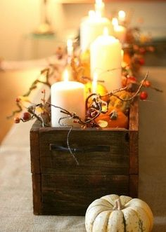 fall centerpiece: brown wooden box with lights, berries, candles and mini gourds!
